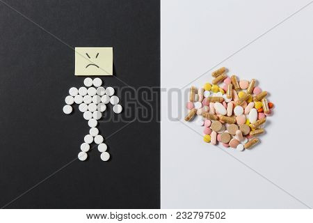 Medication White Colorful Round Tablets Arranged Abstract On White Black Background. Human Sad, Aspi