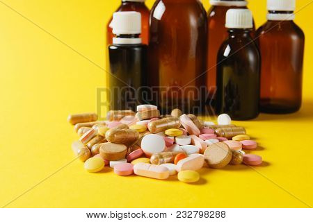 Medication White Colorful Round Tablets Arranged Abstract On Yellow Color Background. Bottle Vial Ca