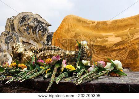 Reclining Buddha Statue In Festive Safran Clothes In Wat Lokaya Sutharam In Ayuttaya, Thailand. Lyin