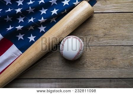 Baseball And Baseball Bat With American Flag On Wooden Table Background