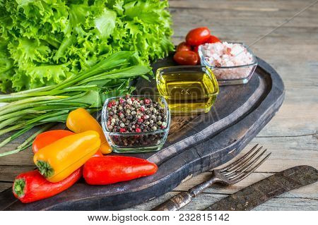 Olive Oil Pepper And Salt Of Cherry And Vegetables For Cooking Vegetarian Salad Spices On Wooden Tab