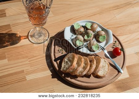 Snails With Herbs Butter, In Traditional Ceramic Pan Bread And Sauce On A Wooden Table. Top Viewsnai