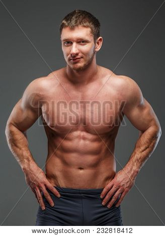 Big Muscled Man With A Smile On His Face Posing Showing His Pumped Muscules