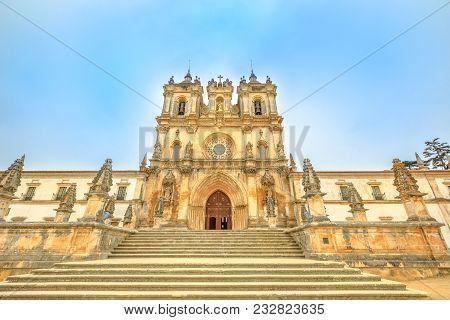 Main Facade Of Roman Gothic Monastery Of Alcobaca Or Mosteiro De Santa Maria De Alcobaca, Unesco Her