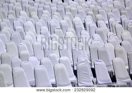 Empty Chairs In Outdoor Auditorium
