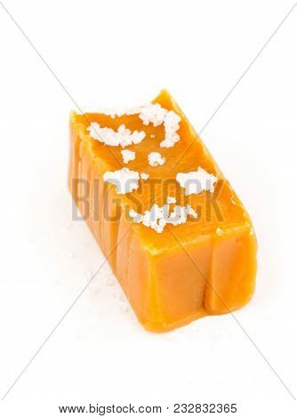 Hand Made Caramel Toffee Piece With Sea Salt Over White Background