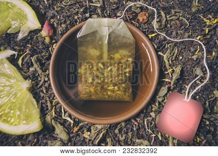 Herbal Tea In A Cup Of Brewed Teabag Closeup Composition And Ready Free Space Copyspace On The Label