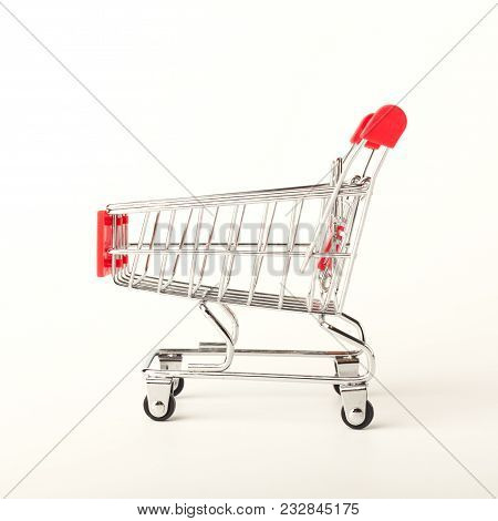 A Studio Shot Of An Empty Shopping Cart Isolated On White Background, Side View. Advertising Of Food