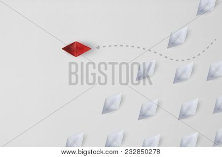 Business Concept Minimal As A Group Of Paper Ship In One Direction And With One Individual Pointing