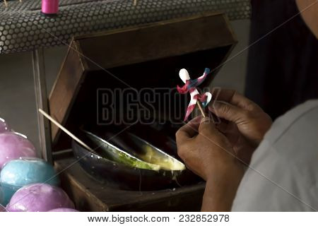 Sugar Doll Traditional Handmade Chinese Art At The Asian Market Or Street Food. Hands's Male Making