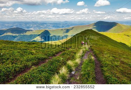 Footpath Through Borzhava Mountain Ridge In Summer. Group Of Tourists Following The Path. Lovely Lan