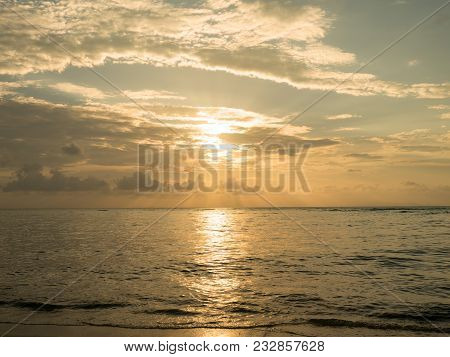 Sunset Over Sea. Sun Light Reflect With Sea Wave Surface And Flare. Summer Time For Vacation And Hol