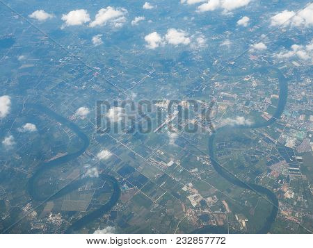 Aerial View Landscape And River Of Perimeter Bangkok City In Thailand With Cloud. View From Air Plan
