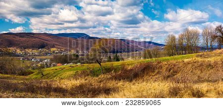 Panorama Of Mountainous Rural Area In Springtime. Lovely Countryside On A Cloudy Day. Leafless Fores