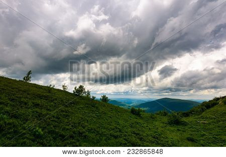 Mountain Landscape In Rainy Weather. Lovely Summer Scenery With Grey Menacing Clouds Over The Grassy