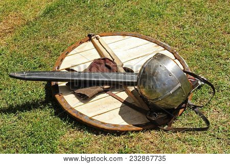 An Ancient Helmet, Sword Are Made Of Metal And Shield For Protection In Battle.