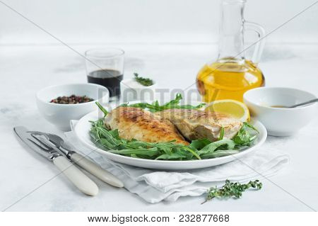 Chicken Breast With Rocket Leaves On Light Background
