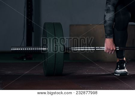 Close-up - Male Athlete Preparing For Dead Lift Exercise With Barbell. Weightlifting, Power Lifting