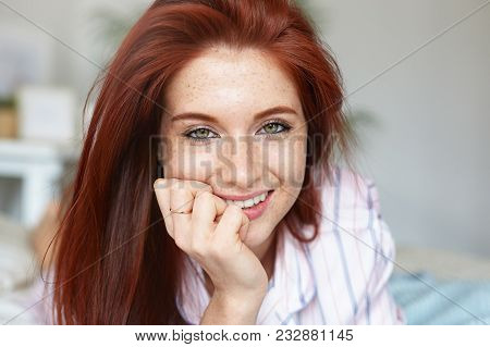 Close Up Portrait Of Attractive Red Haired Young Caucasian Woman With Green Eyes And Perfect Freckle