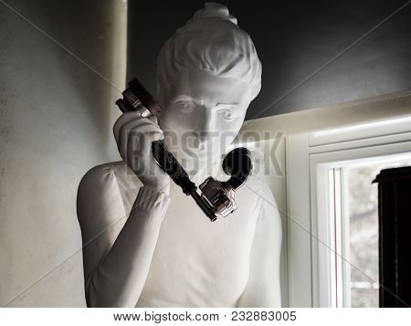 Moscow, Russia - March 20, 2018: Sculpture Of Woman Holding Retro Black Telephone Handset In The Mus