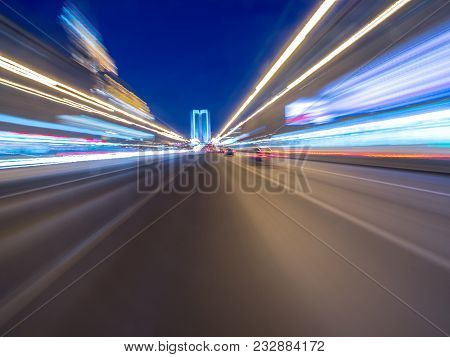 Speed Motion On The Neon Glowing Road At Dark. Speed Motion On The Road. Colored Light Streaks Accel