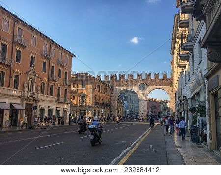 Verona, Italy - May 26, 2017: A Marble And Red-brick Gateway Called Portoni Della Bra With An Impres