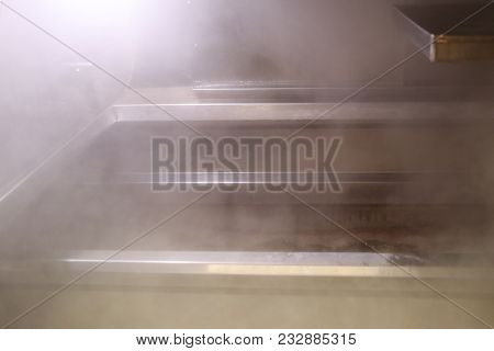 Steam Rises From Boiling Maple Sap As It Gets Turned Into Maple Syrup Inside An Evaporator