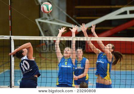 KAPOSVAR, HUNGARY - APRIL 24: Zsanett Pinter (2) blocks the ball at the Hungarian NB I. League woman volleyball game Kaposvar (blue) vs Ujbuda (black), April 24, 2011 in Kaposvar, Hungary.
