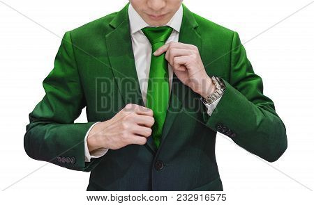 Businessman In Green Suit Tying Green Necktie, Isolated On White Background