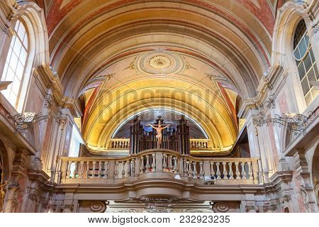 Lisbon, Portugal - October 24, 2016: Choir balcony, pipe organ and crucifix of the Santo Antonio de Lisboa Church. Built on the Saint Anthony of Lisbon aka Padua or Padova birthplace.  Baroque style