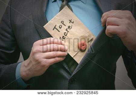 Top Secret Concept. Top Secret Documents Or Message In Businessman Hands. Confidential Dossier Infor