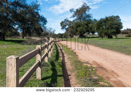 A Wooden Fence Lines A Walking Trail At Ramona Grasslands Preserve In San Diego, California.