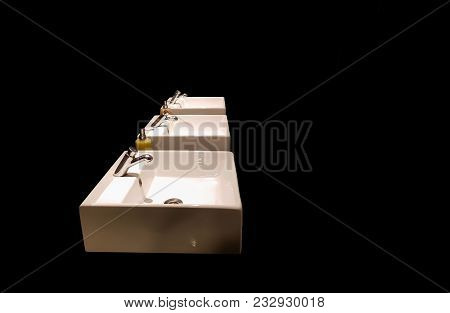 Wash Basins In Black Background For Interior