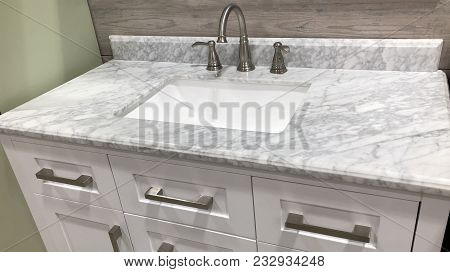 Bathroom sink, white china sinks, marble counter with under mount sink, rectangular sink with faucet and white cabinets