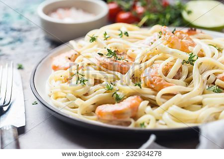 Italian Pasta Fettuccine In A Creamy Sauce With Shrimp On A Plate, Close-up.
