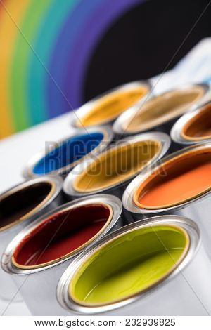 Full Buckets of rainbow colored oil paint