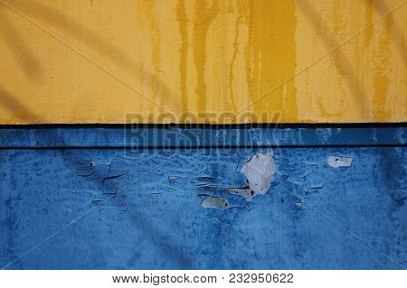 Yellow blue metal background. Metal background. Rusty metal background. Grunge metal.Grunge background. Metal style. Yellow and blue.