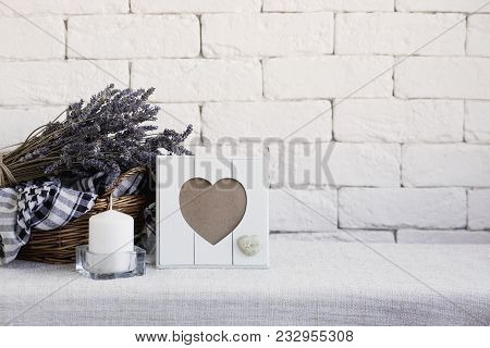 Lavender In A Basket On A White Brick Wall Background