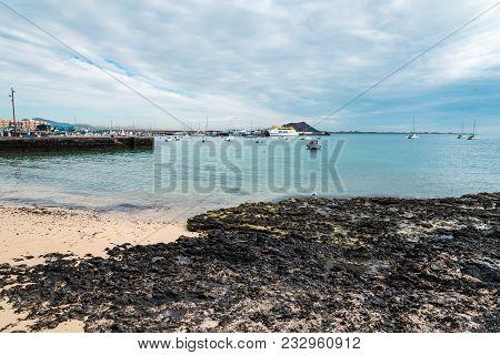 Corralejo, Fuerteventura, Canary Islands, Spain - February 16, 2018: Harbour Of Corralejo Bay And Lo