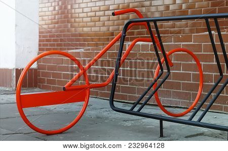 Bicycle Parking In A Modern City.red Bicycle Parked In Bicycle Parking