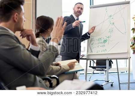 Portrait Of Bearded Business Coach  Standing By Whiteboard Giving Presentation For Audience And Answ