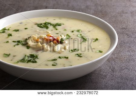 Romanian Traditional Soup - Ciorba De Burta Seasoned With Vinegar And Horseradish In White Bowl