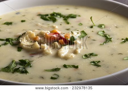 Close Up Of Romanian Traditional Soup - Ciorba De Burta In White Bowl