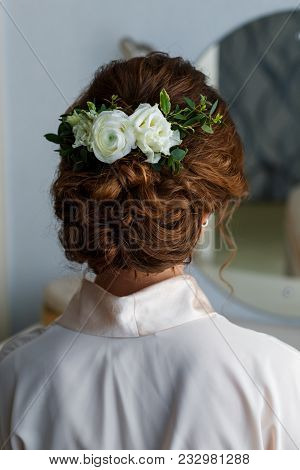 Bride With White Natural Flowers In Her Hair And Wedding Bouquet In Forest. Portrait Of Attractive Y