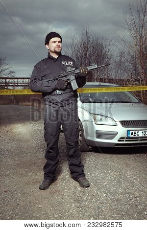 Crime Scene Investigation - Police Officer Guarding Place Of Investigation