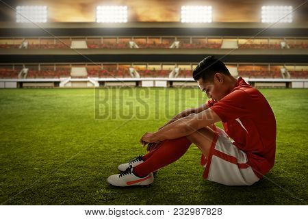 Soccer Player Lose The Match Sitting On The Field