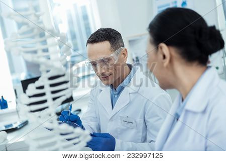 Research Methodology. Professional Scientist Conducting A Research While Studying Bioengineering