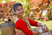 Assamese girl In traditional attire posing with A Dhol or Drum, Pune, Maharashtra. poster