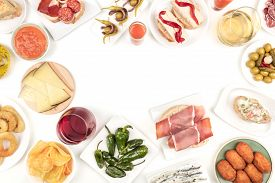 An Overhead Photo Of A Collection Of Spanish Tapas Food, Shot From Above On A White Background, Form