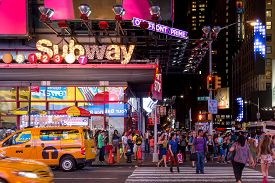 New York City, Usa - Aug 17, 2016: People Crossing The Street In Nyc Near Times Square-42 Street Sub